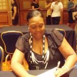 Jacqueline Thomas signing my book